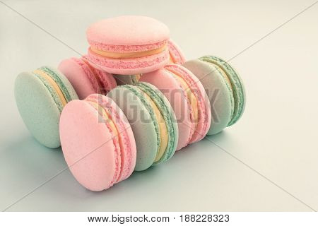 Assortment of mint and strawberry colorful macaroons with copy space