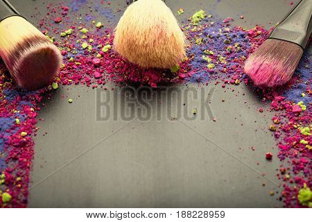 Close-up of make-up brushes on black frame background
