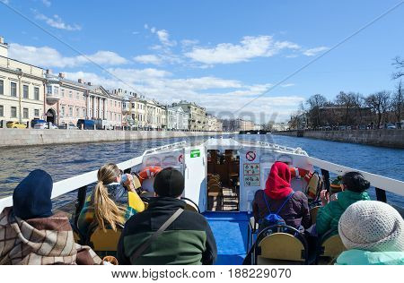 SAINT PETERSBURG RUSSIA - MAY 3 2017: Unknown tourists on excursion ship on Fontanka River St. Petersburg Russia