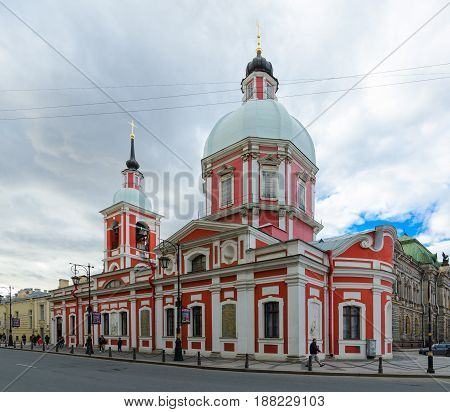 SAINT PETERSBURG RUSSIA - MAY 3 2017: Unknown people are walking along street near Church of Holy Great Martyr and Healer Panteleimon (Panteleimon Church) view from intersection of Pestel Street and Solyany Pereulok St. Petersburg Russia