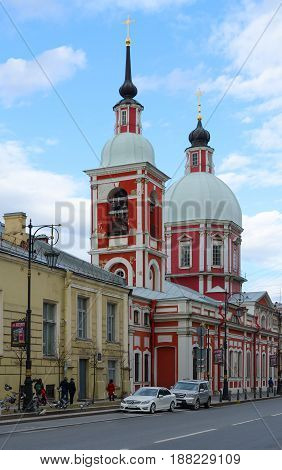 SAINT PETERSBURG RUSSIA - MAY 3 2017: Unknown people are walking along Pestel Street near Church of Holy Great Martyr and Healer Panteleimon (Panteleimon Church) St. Petersburg Russia