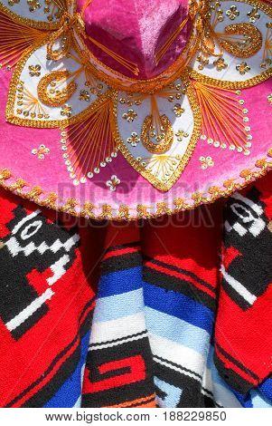 Mexico poncho and serape sombrero close up