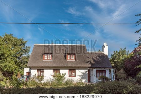 GREYTON SOUTH AFRICA - MARCH 27 2017: An old house with thatched roof in Greyton a small town in the Western Cape Province of South Africa