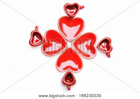 Plates And Cups Of Red Colour And Heart Shape