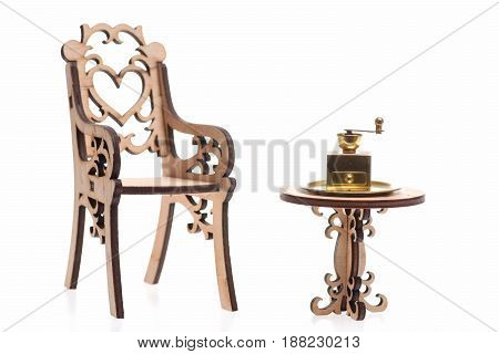 Coffee Grinder antique vintage brass ware on golden tray on decorative wooden table with engraved chair isolated on white background