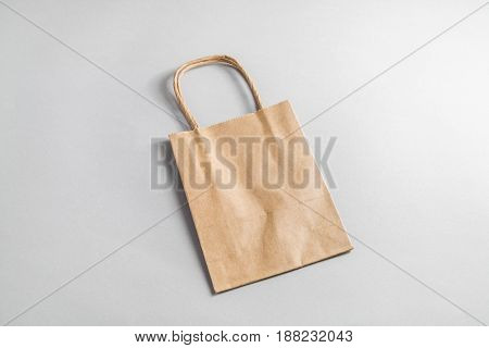 Recycled paper shopping bag on paper background. Craft paper package.