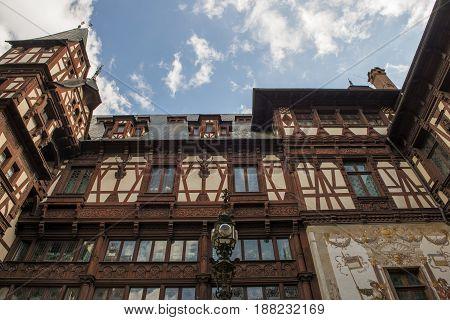 pelesh castle facade close-up view with blue sky