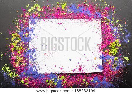 Colorful make-up shadows powder crumbled on white frame with copyspace. Makeup template background. Flat lay,