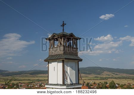 old church bell tower with cloudy blue sky