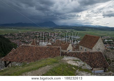 old village from above with storm approaching
