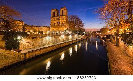 Notre Dame de Paris cathedral on Ile de La Cite at dawn with the Seine River. Daybreak in the 4th Arrondissement Paris France