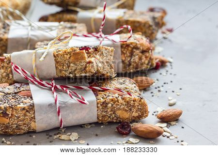 Homemade granola energy bars with figs oatmeal almond cranberry chia and sunflower seeds healthy snack copy space