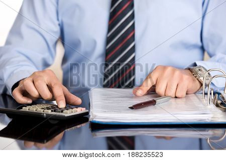 Businessman Doing Calculations high quality and high resolution studio shoot