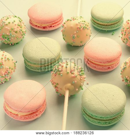 Close-up of macaroons mixed with cake pops
