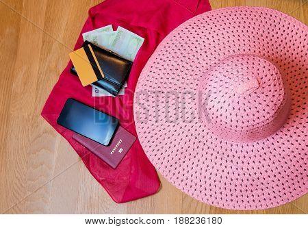 Travel accessories. Hat wallet passport credit card on wooden background