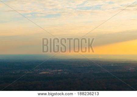 Aerial view of forest and settlements from the top of the Stone Mountain at sunset Georgia USA