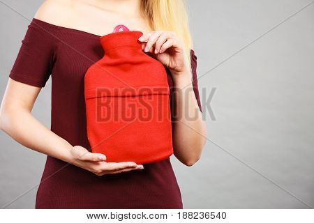 Woman Holding Warm Red Hot Water Bottle