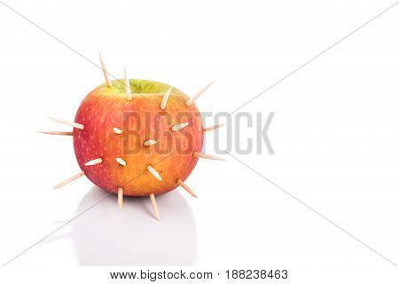 Conceptual Of Apple With Thorns Denote Sharp Pain When Bite
