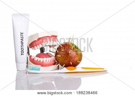Conceptual Of Model Mouth Bite  Apple With Thorns, Toothbrush, Toothpaste,