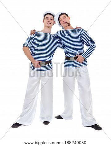 Two male dancers dressed as a sailor posing against isolated white background in full length.