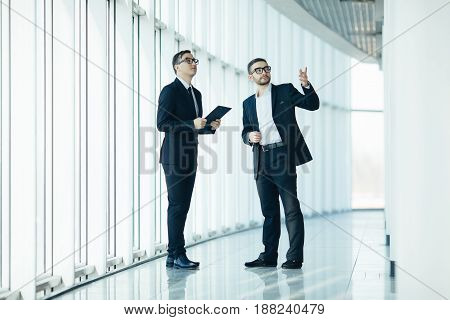 Boss And Manager Dicussing Change In Big Construction Of Hall Room