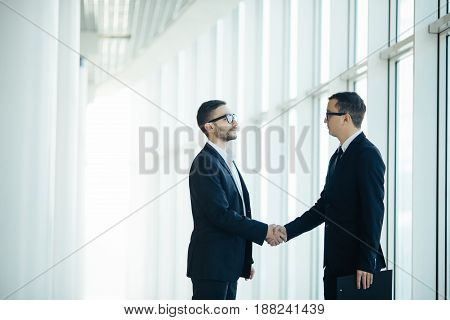 Boss And Manager Agree Handshake In Office Panoramic Room