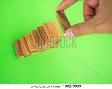 Human putting wooden block to build stair case level