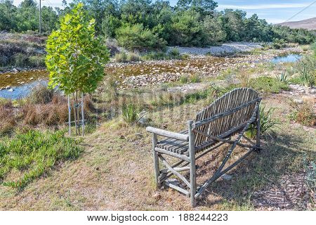 A bench next to the Gobos river at Greyton a small town in the Western Cape Province of South Africa
