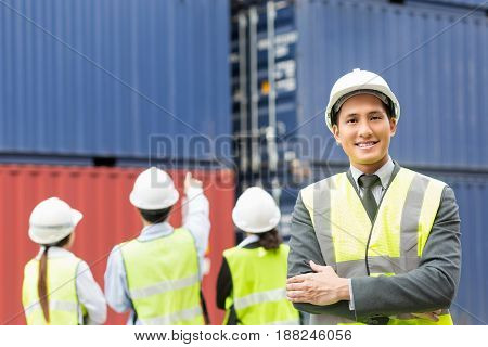 Asian businessmanAsian secretary foreman working inspecting on-line device in yard in container Cargo freight ship in shipyard for Logistic Import Export background