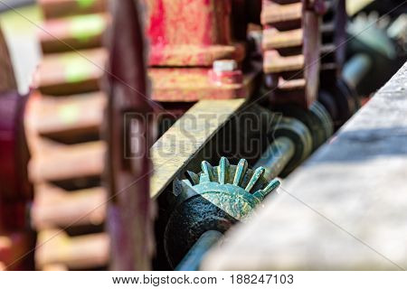 Old Gears And Cogs Against Blurred Background