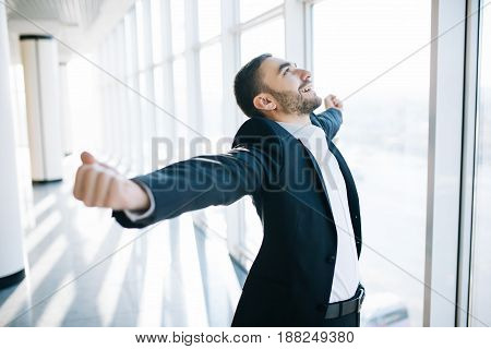 Excited Young Caucasian Businessman Celebrate Victory Cheerful In Modern Office