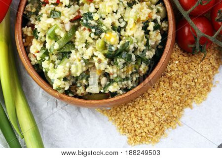 Tabbouleh Salad With Bulgur, Parsley And Vegetables -diet Concept