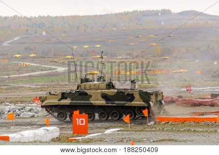 Nizhniy Tagil Russia - September 25. 2013: Airborne tracked armoured personnel carrier BMD-4M with additional protection on demonstration range. Russia Arms Expo-2013 exhibition