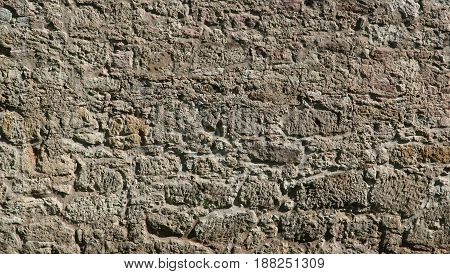 old stone wall made of natural stone background