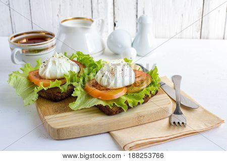 Healthy Breakfast sandwich with poached eggs. Healthy eating and diet concept. Selective focus.