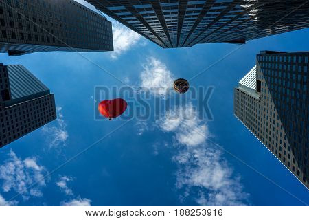 Baloon flying over modern building in Singapore city downtown