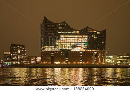 HAMBURG, GERMANY - NOVEMBER 14. Elbphilharmonie at night as main attraction in Hamburg on November 14, 2016. The building is deliberately designed Maritime. The forms are reminiscent of ships and port