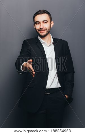 Young Businessman In Suit Give Hand Shake  Isolated