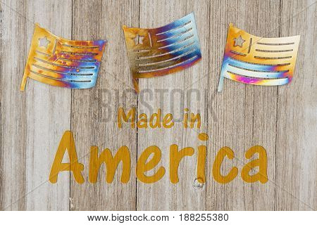 Made in America text with USA patriotic old metal flags on a weathered wood