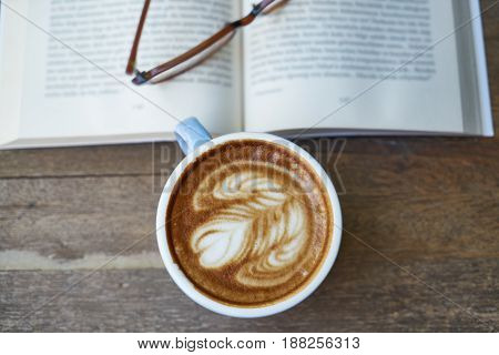 Morning Coffee Time on Brown Wooden Background