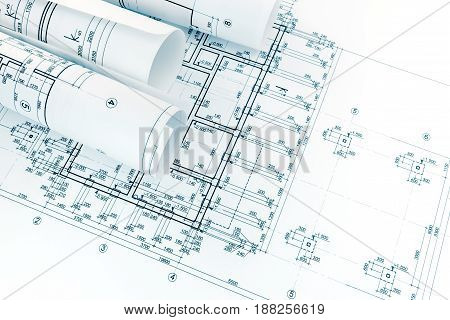 Rolls Of Drawing Paper With Project Blueprints And Architectural Plans