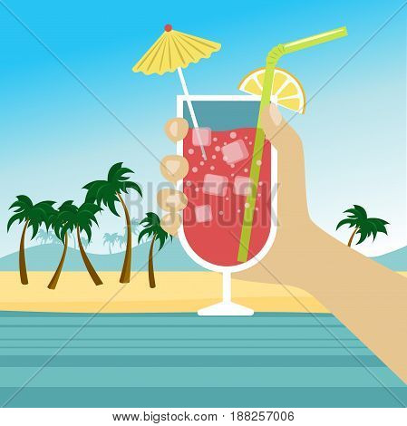 Hand holding a cocktail with icecubes, straw and umbrella over tropical beach