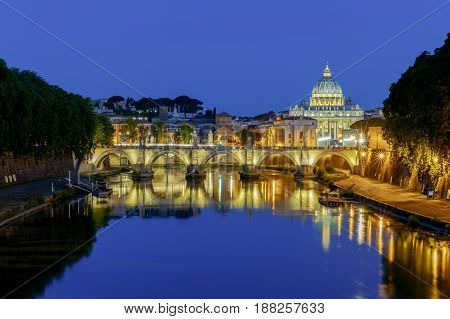 Night view of the Tiber River and St. Peter's Cathedral in the Vatican. Italy.
