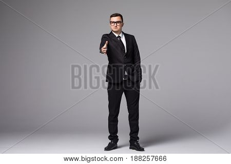 Young Businessman In Suit Give A Hand Shake Isolated
