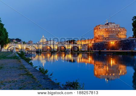 Castel Sant'Angelo and Sant'Angelo bridge across the river Tiber in the night light. Rome. Italy.