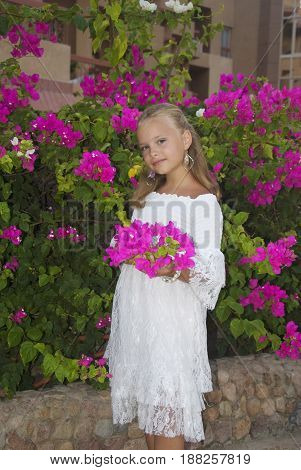 Happy child with flower outdoors in summer