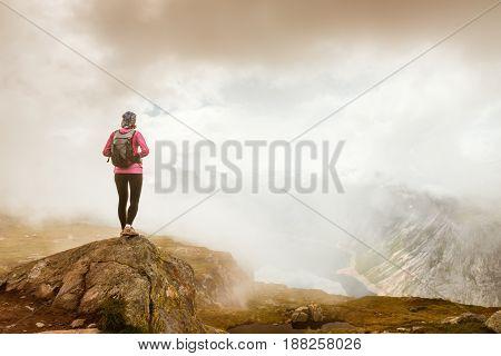 Happy sporty woman enjoy beautiful lake in Norway mountains