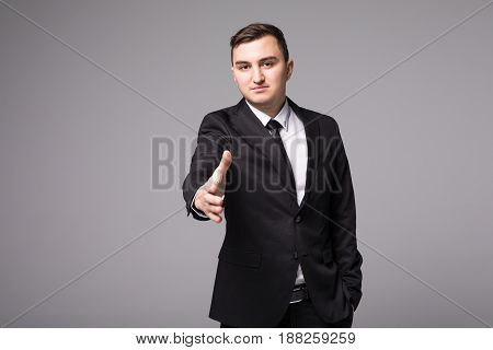 Young Businessman In Suit Hand Shake Isolated