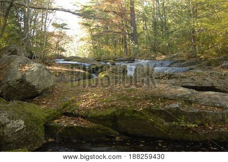 Rocky river bed in early autumn New Hampshire