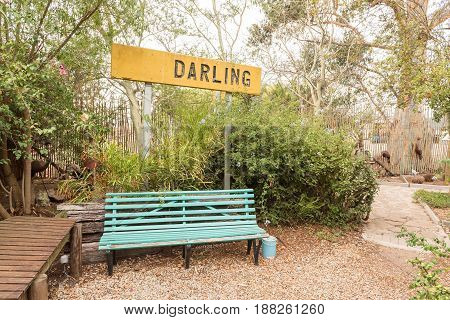 DARLING SOUTH AFRICA - MARCH 31 2017: A bench and name sign at Evita se Perron in Darling a town in the Western Cape Province